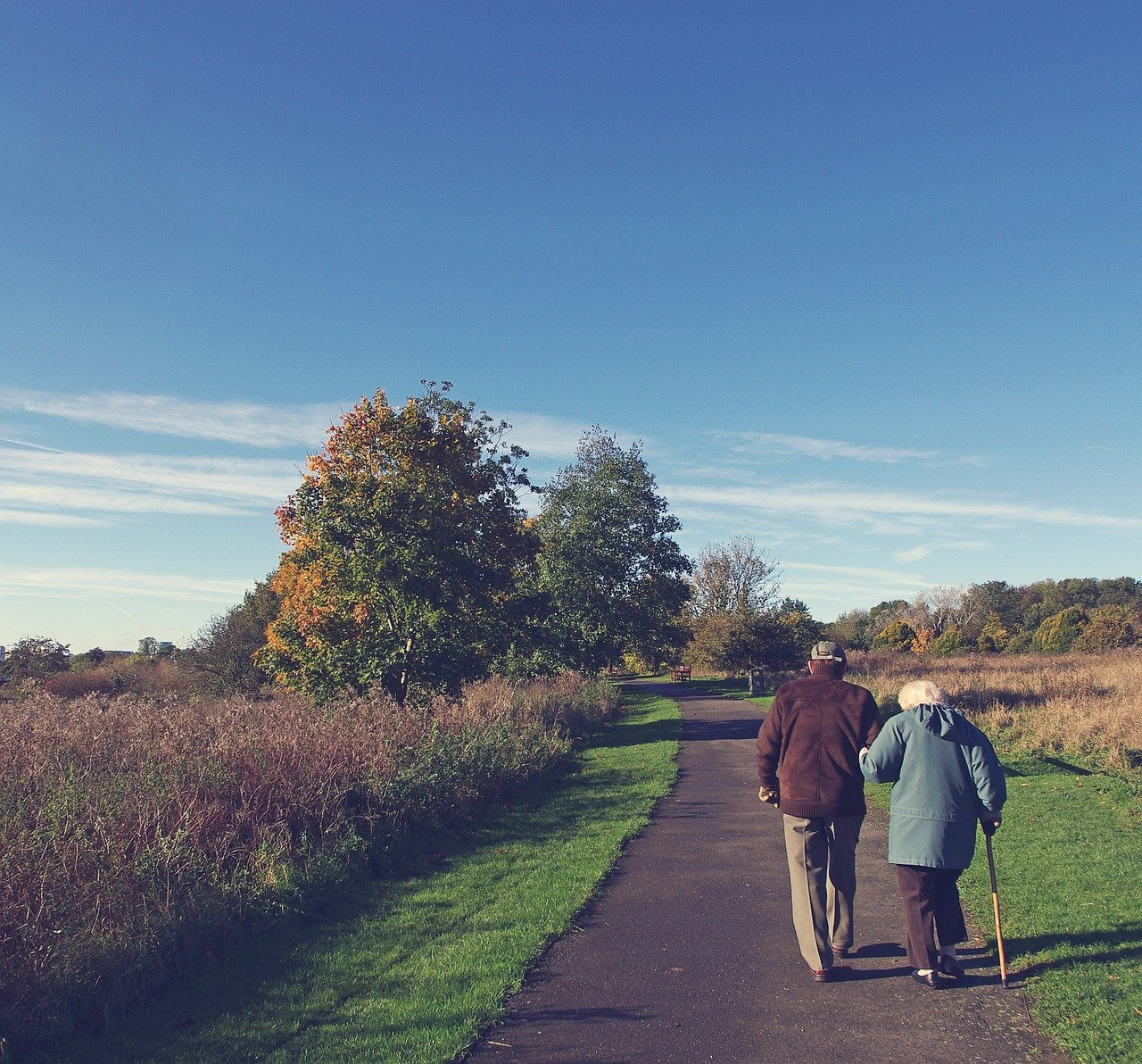 older retired couple walking down path